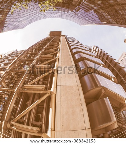 LONDON, UK - SEPTEMBER 29, 2015: Lloyd of London is an iconic high tech skyscraper designed by architect Richard Rogers seen with fisheye lens vintage