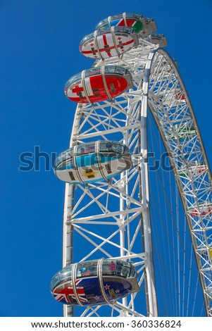 LONDON, UK - SEPTEMBER 10, 2015: London eye is a giant Ferris wheel opened on 31 December 1999, the most famous attraction in centre London - stock photo