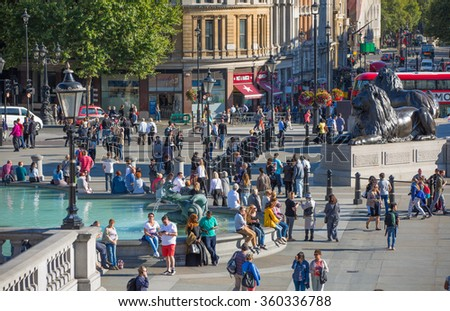 LONDON, UK - SEPTEMBER 10, 2015: Lots of people and tourists on the Trafalgar square in hot summer day - stock photo