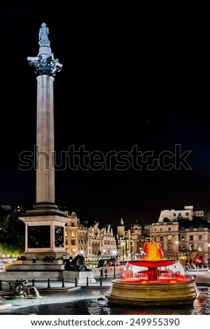 LONDON, UK - SEPTEMBER 1, 2013: Night shot of Trafalgar Square. Nelson's Column built to commemorate Admiral Horatio Nelson, who died at the Battle of Trafalgar in 1805. - stock photo