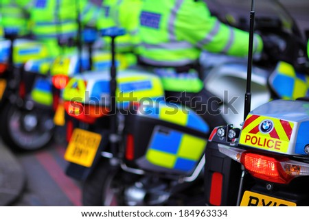 LONDON, UK - SEPTEMBER 7: Police motorcycles were waiting by the Tower bridge for permission to go as something was happening by Tower bridge on September 7, 2013 - stock photo