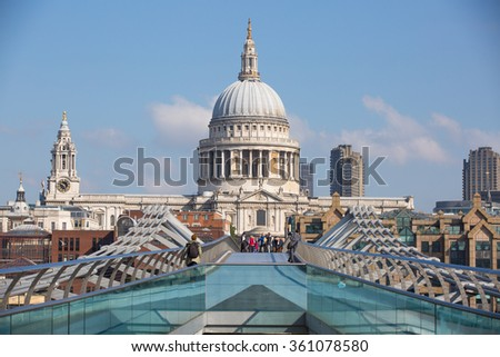 LONDON, UK - SEPTEMBER 10, 2015: St. Paul's cathedral and tourists making selfie at millennium bridge