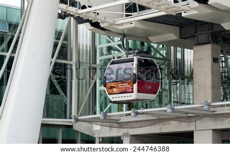 LONDON, UK  SEPTEMBER 7TH, 2014: The London Cable Car (otherwise known as the Emirates Cable Car) transporting passengers over the River Thames in Greenwich, London.