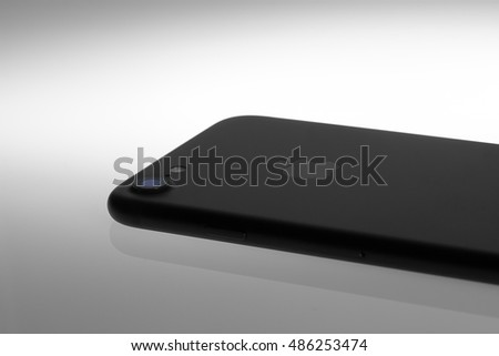 London, UK - 20 September 2016: The Apple iPhone 7 launched with a 12MP camera and quad-LED true tone flash. This image is of the back of a black iPhone 7 showing the logo, camera lens and flash.