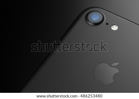 London, UK - 20 September 2016: The Apple iPhone 7 launched with a 12MP camera and quad-LED true tone flash. This image shows a close up of the camera lens and flash on the back of a black iPhone 7.
