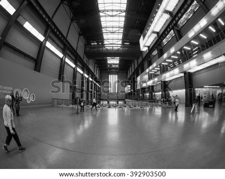 LONDON, UK - SEPTEMBER 28, 2015: The Turbine Hall once housed the electricity generators of the power station now a public space part of Tate Modern art gallery in black and white