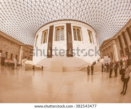 LONDON, UK - SEPTEMBER 28, 2015: Tourists in the Great Court at the British Museum designed by architect Lord Norman Foster opened in year 2000 seen with fisheye lens, vintage