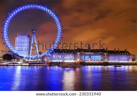 LONDON, UK - SEPTEMBER 20, 2014: View of the London Eye at night on September 20, 2014. The London Eye is a famous tourist attraction on river Thames in the capital city London.  - stock photo