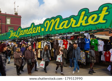 LONDON, UK - 1ST MARCH 2014: The Entrance to Camden Market with shoppers outside walking past or browsing the stalls - stock photo