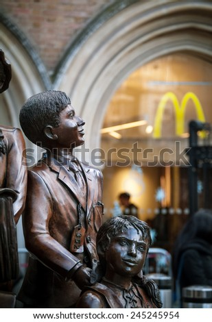 LONDON, UK - 20TH DECEMBER 2014: Part of the Children of the Kindertransport, a 2006 sculpture by Frank Meisler installed outside the Liverpool Street station in London - stock photo