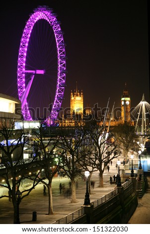 LONDON, UK - 9TH FEBRUARY 2008: View of the South Bank, Houses of Parliament and the London Eye at night. - stock photo