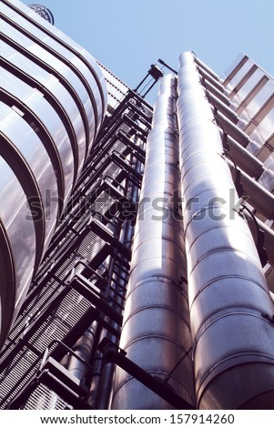 LONDON, UK - 6TH JULY 2013: The Lloyds Building photographed in the City of London on 6th July 2013. Designed by architect Richard Rogers, the Lloyds building is famous for its bowellist style.