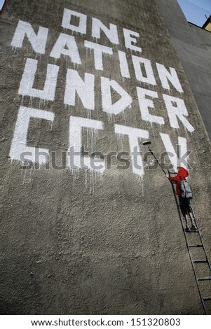 "LONDON, UK - 17TH JUNE 2008: Banksy's ""One Nation Under CCTV"" Graffiti located off of Oxford Street, London."