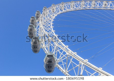 LONDON, UK - 9TH MARCH 2014: A low angle view of the London Eye on a bright day - stock photo