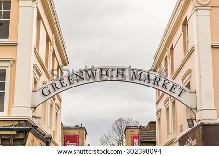 LONDON, UK - 24TH MARCH 2015: A sign towards an entrance to Greenwich Market in London during the day - stock photo
