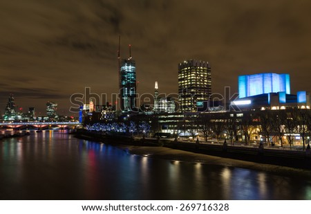 LONDON, UK - 8TH MARCH 2015:  Part of the London Skyline at night showing buildings in central London, including the Shard, OXO, IBM and 20 Fenchurch Street - stock photo