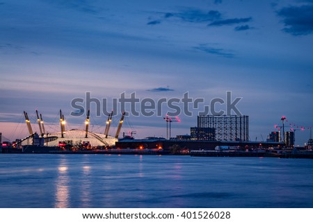 London, UK - 30th March 2016: The O2 Arena in London from across the River Thames at sunset - stock photo