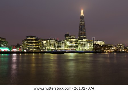 LONDON, UK - 9TH MARCH 2015: The Shard, City Hall, More London and other buildings from across the River Thames at night - stock photo