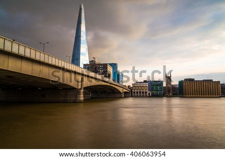 LONDON, UK - 25TH MARCH 2015:  The Shard, London Bridge and other buildings as seen from across the River Thames - stock photo