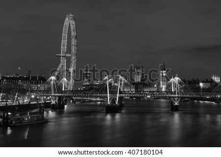 LONDON, UK - 8TH MARCH 2015: The Westminster Skyline from the East showing the London Eye, Hungerford Bridge, Westminster and other buildings - stock photo