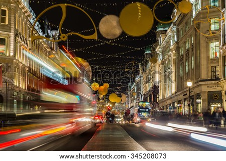 LONDON, UK - 27TH NOVEMBER 2015: A view along Regent Street in London at night during the Christmas Season showing the streets and decorations. Traffic and people can be seen.
