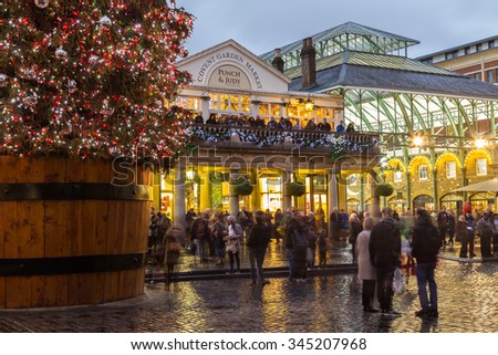 LONDON, UK - 27TH NOVEMBER 2015: The outside of Covent Garden at Christmas showing the tree and decorations. People can be seen. - stock photo