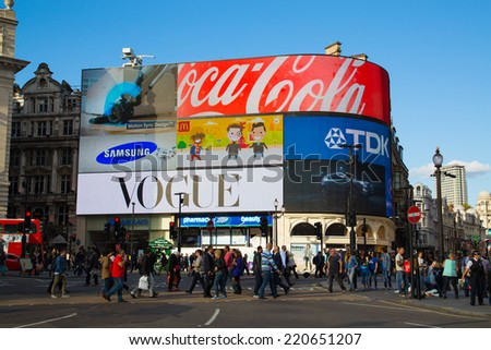 LONDON, UK - 26TH SEPTEMBER 2014: Part of Piccadilly Circus during the day showing large amounts of people outside