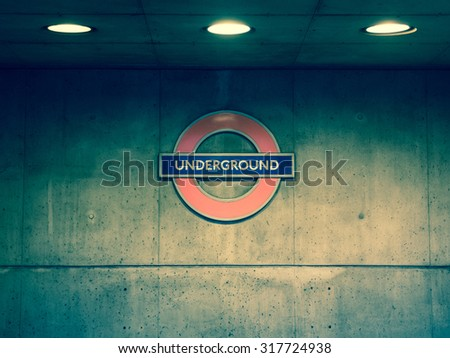 London underground sign near the Westmisnster station on concrete wall - stock photo