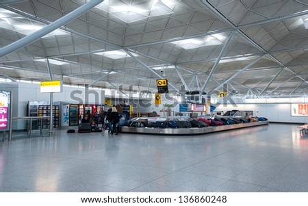LONDON, UNITED KINGDOM - APRIL 9: Conveyor belt in Stansted airport April 9, 2013 in London, UK. It was the 4th busiest airport in the UK with 17.4 million passengers. - stock photo