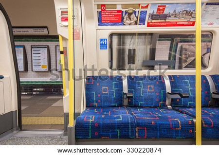 LONDON, UNITED KINGDOM  - APRIL 14, 2013: Empty underground wagon. The Underground system serves 270 stations and has 402 kilometres (250 mi) of track, 45 per cent of which is underground. - stock photo