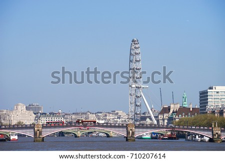 London, United Kingdom. April 9, 2017. London's Iconic Attractions View of The Eye with The Red Buses Driving on The Lambeth Bridge, Lambeth, London
