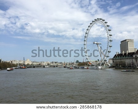 LONDON, UNITED KINGDOM - APRIL 16, 2015: Panorama of Thames river with London Eye in sunny day. London is the world's most-visited city as measured by international arrivals. - stock photo