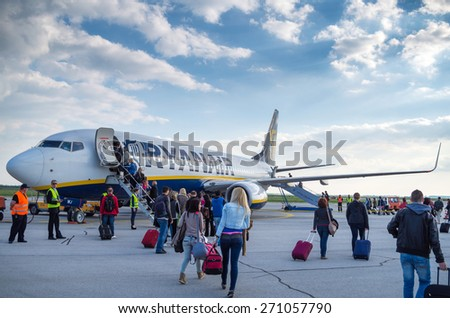 LONDON, UNITED KINGDOM - April 12, 2015: Passengers boarding a Ryanair Boeing B737 in Stansted airport near London, UK - stock photo