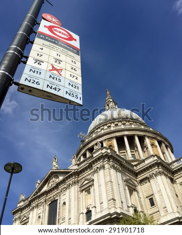 LONDON, UNITED KINGDOM - APRIL 18, 2015: St Pual cathedral with London'd bus stop. London is the world's most-visited city as measured by international arrivals. - stock photo