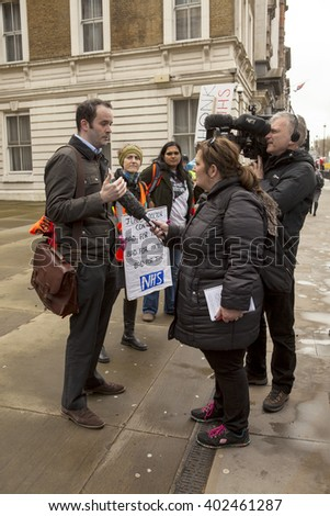 London, United Kingdom - April 6, 2016:The Fourth Junior Doctors' Strike. BBC journalists interview a junior doctor at the junior doctor rally outside the Department of Health.