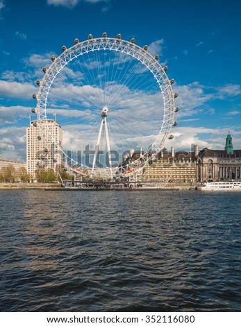 LONDON, UNITED KINGDOM - 26 APRIL,2015: The London Eye on the South Bank of the River Thames at sunset n London, England on 26 April 2015. - stock photo