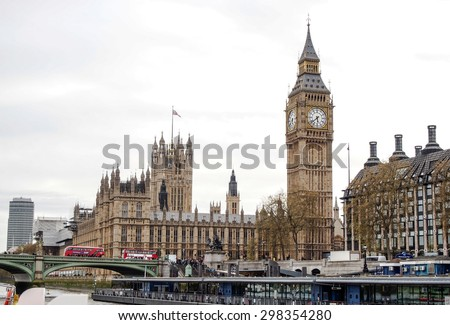 LONDON, UNITED KINGDOM - APRIL 18, 2015: tourists at Westminster and the most famous London landmark Big Ben. London is the world's most-visited city as measured by international arrivals. - stock photo