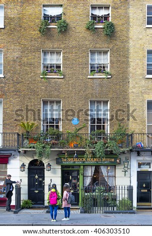 London, United Kingdom - April 3, 2016: Tourists gathered near The Sherlock Holmes Museum on Baker Street 221B on April 3, 2016. It is a popular spot for Sherlock Holmes fans from around the world.
