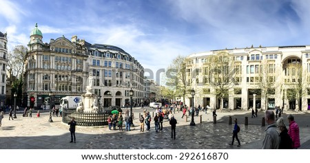 LONDON, UNITED KINGDOM - APRIL 18, 2015: Tourists in front of St. Paul cathedral, one of the most visited place in London. London is the world's most-visited city as measured by international arrivals - stock photo