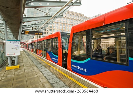 LONDON, UNITED KINGDOM - APRIL 11, 2013: Train at Canary Wharf DLR station. It opened in 1991 and it had over 20.000 million passengers. - stock photo