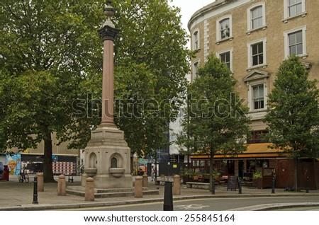 LONDON, UNITED KINGDOM - AUGUST 30, 2014:  Landmark historic St Leonard Column in a small square in Hoxton, London. - stock photo