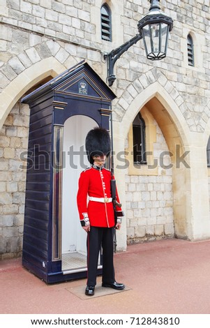 LONDON, UNITED KINGDOM - AUGUST 22, 2017 : Royal Guard at Windsor Castle, England. British Guards in red uniform are the sign of London. The Scots Guards (SG)