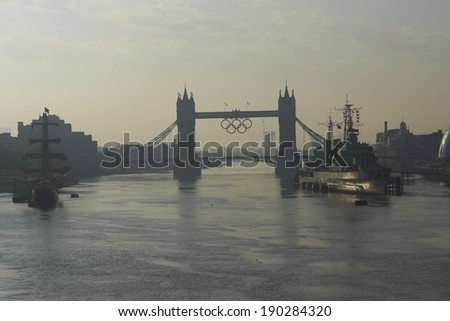 LONDON, UNITED KINGDOM - AUGUST 12, 2012:  Tower Bridge decorated with the Olympic Rings as part of the London 2012 Olympic Games - stock photo
