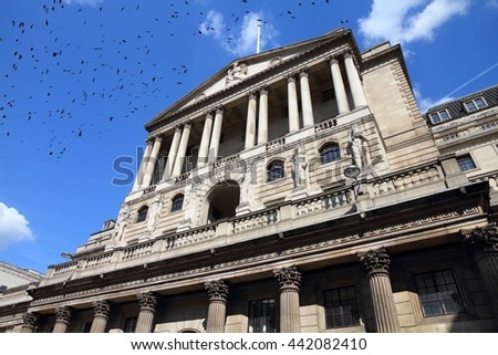 London, United Kingdom - Bank of England building with ominous crows. - stock photo
