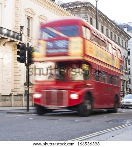 LONDON, UNITED KINGDOM - CIRCA NOVEMBER 2013:Red vintage bus in London. London City tour - stock photo