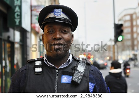 London, United Kingdom - 28. December  2007., Community Support Officer of the Metropolitan Police,Portrait captured on the street of London and with the will of Officer to pose, some noise may occur - stock photo