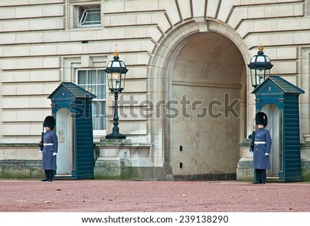 LONDON, UNITED KINGDOM - 11 DECEMBER, 2014: Queen's Guard at Buckingham Palace, London on 11 December, 2014.  - stock photo