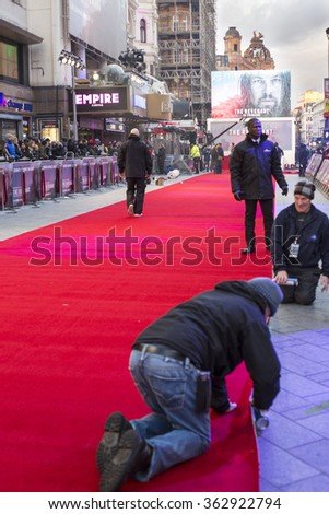 London, United Kingdom - JAN 14, 2016: Red carpet setting up and waiting queue at The Revenant London Premiere, Empire Cinemas on Leicester square. Great anticipation for Leonardo Di Caprio arrival. - stock photo