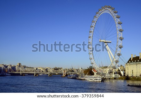 LONDON, UNITED KINGDOM - JANUARY 15: Giant wheel named London Eye on river Thames and Golden Jubilee bridge, on January 15, 2016 in London, England