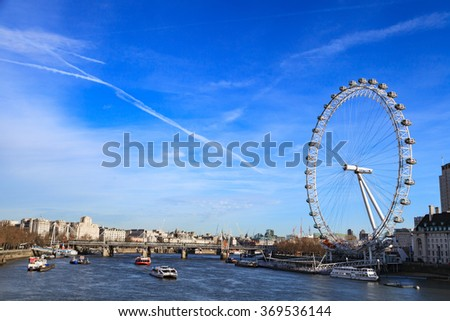 LONDON, UNITED KINGDOM â?? 25 JANUARY 2016: London Eye is the tallest Ferris wheel in Europe and Country Hall in London, United Kingdom